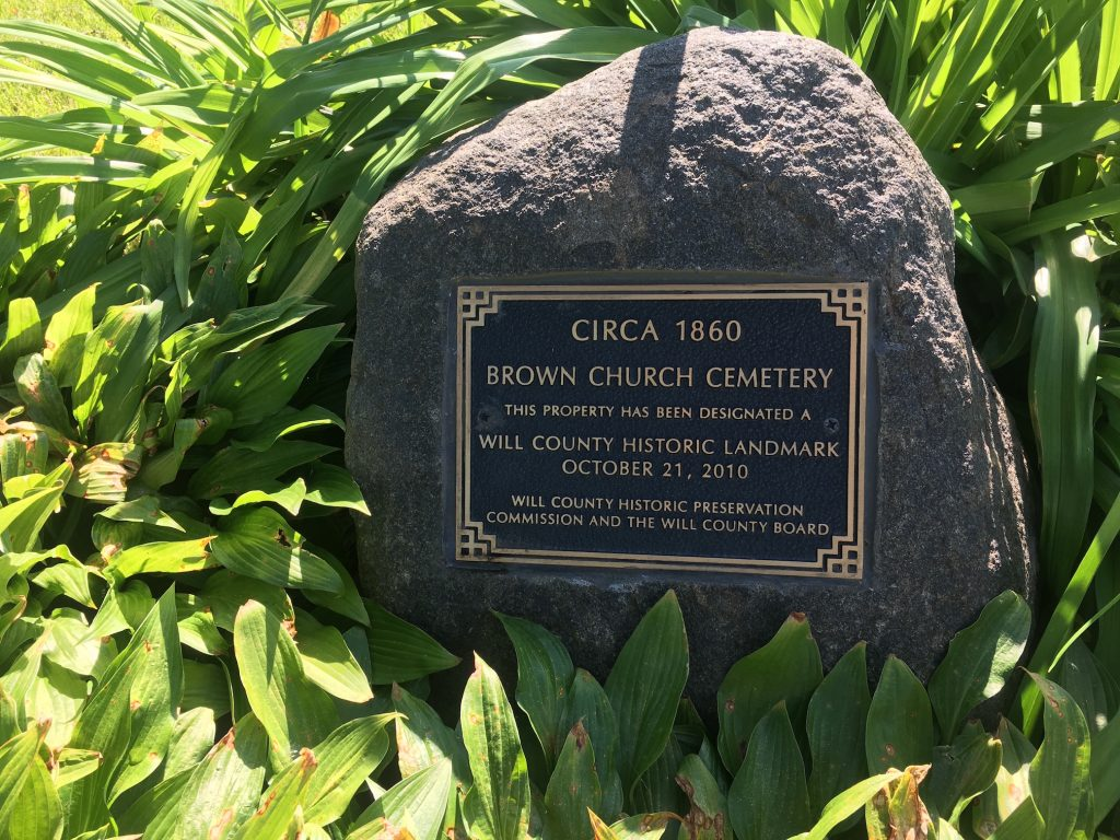 Photo of landscape rock with Will County Historical Landmark recognition plaque at Brown Church Cemetery in Will County
